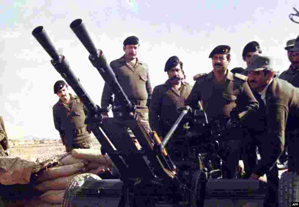 Saddam Hussein at the front during the Iran-Iraq war. Iraq invaded Iran in 1980, leading to a conflict that lasted eight years and claimed 1.7 million lives.