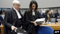 France -- Lawyers representing Armenia, Amal Clooney (R) and Geoffrey Robertson, arrive for the start of the appeal hearing in Perincek case before the European Court of Human Rights in Strasbourg, January 28, 2015