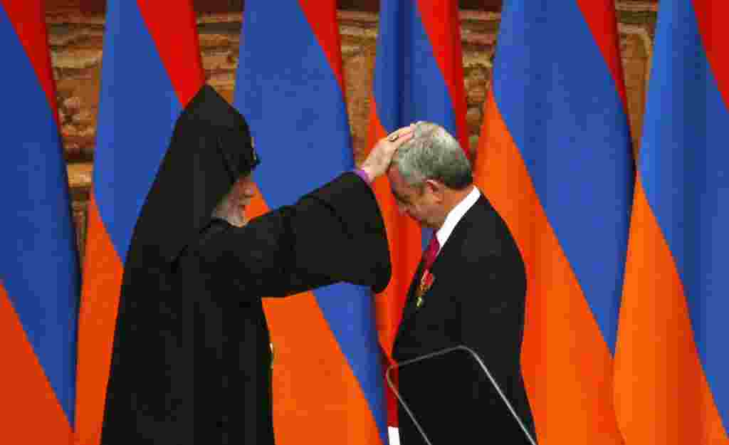 Catholicos of All Armenians Karekin II blesses President Serzh Sarkisian during his inauguration ceremony for another term in Yerevan. (Reuters/Tigran Mehrabyan)