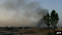 Smoke rises over the city of Ghazni after Taliban militants launched an attack on the Afghan provincial capital late on August 9.