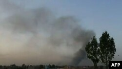 Smoke rises into the air after Taliban militants attacked the Afghan provincial capital, Ghazni.