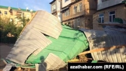 A residential building damaged from the storms in Turkmenistan's Lebap Province.