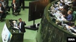 Iranian President Mahmud Ahmadinejad (left) and speaker Ali Larijani traded accusations in parliament.