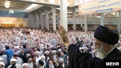 Supreme Leader Ayatollah Ali Khamenei addresses a crowd in the holy city of Qom on October 21. Would his website publish images of protests?