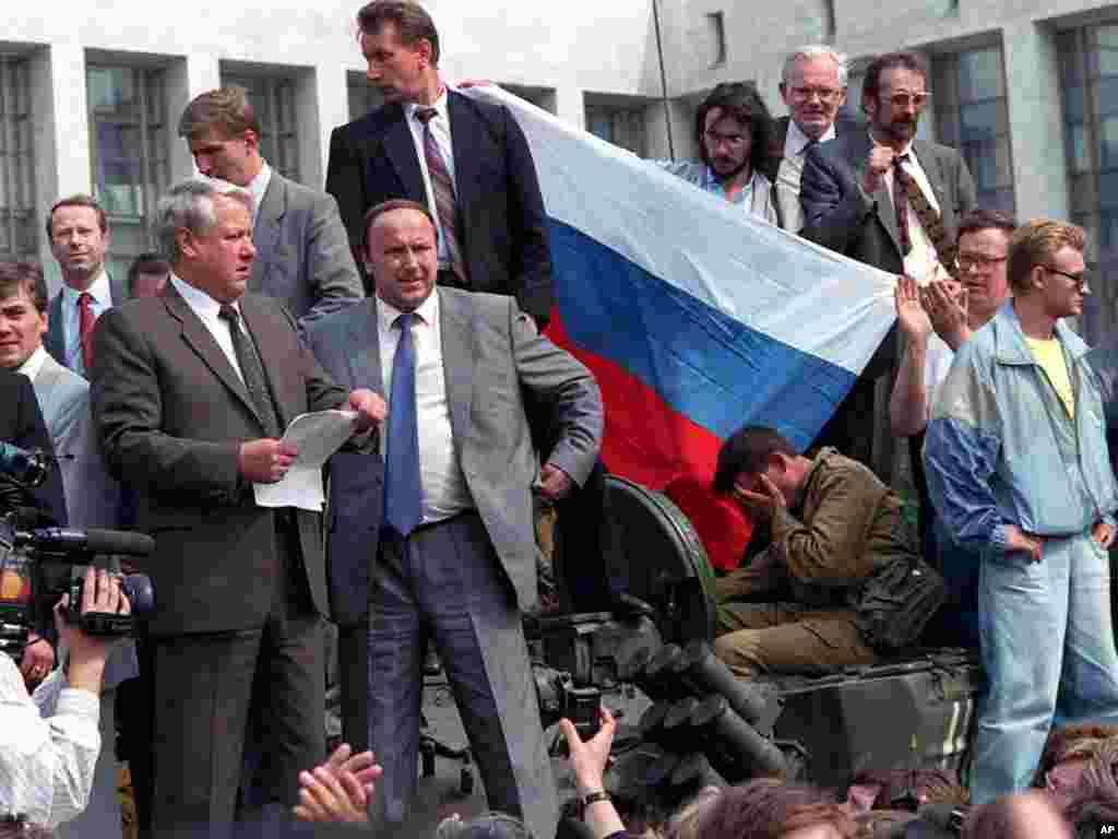 Russian President Boris Yeltsin stands atop a tank in Moscow on August 19, 1991, and calls for a general strike.