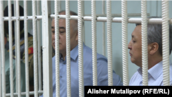 Omurbek Tekebaev (left) and Duishonkul Chotonov appear in court on June 5.