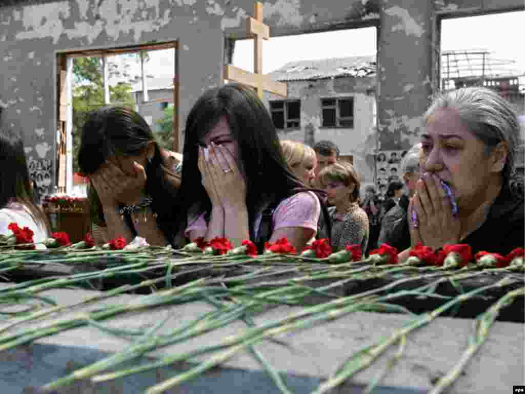 Mourners remember the victims at a memorial services in Beslan.