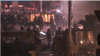 Police and protesters face off in Kyiv in the early morning hours of January 21, after a tense night that saw Molotov cocktails, bottle rockets, and stun grenades exchanged between protesters and police.
