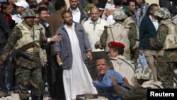 Egyptian Army soldiers restrain a supporter of President Hosni Mubarak near Tahrir Square.