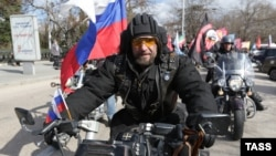 Aleksandr Zaldostanov, leader of the Night Wolves biker group, takes part in a commemoration ceremony for soldiers killed during WWII at the World War II memorial in Sevastopol, Crimea, on March 17.