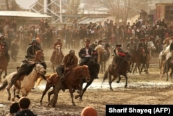 Horsemen compete during a game of the buzkashi in the northeastern Afghan city of Badakhshan in February 2018.