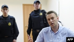 Russian opposition leader Aleksei Navalny after a Moscow court hearing on June 12