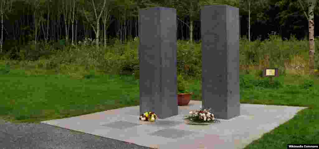 ...and a similar memorial in Ireland's Donadea Forest Park. This work is dedicated to firefighter Sean Tallon, whose family had emigrated from Donadea, and to other emergency workers and public servants who died in the attacks.