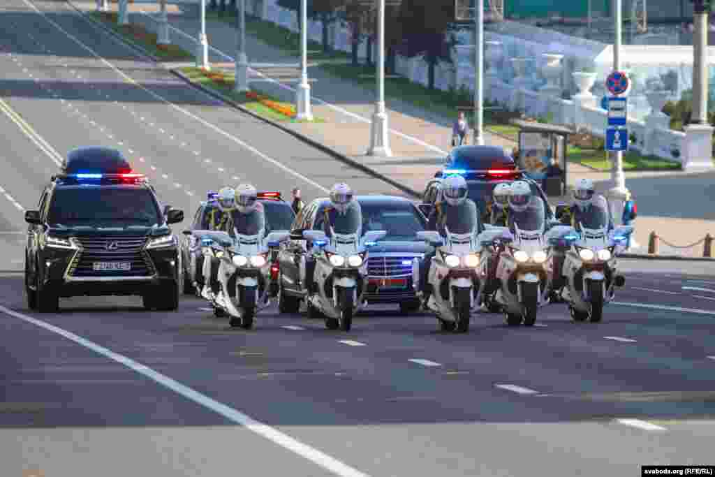 Lukashenka's motorcade moves along the empty Independence Avenue in Minsk, which was closed to traffic in the morning.