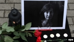 Flowers near the photo of slain journalist and human rights activist Natalya Estemirova in Moscow in August 2009