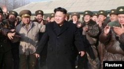 The trip would be the first foreign visit by North Korean leader Kim Jong Un (center), 31, since he assumed leadership of the isolated and tightly controlled East Asian state in 2011.