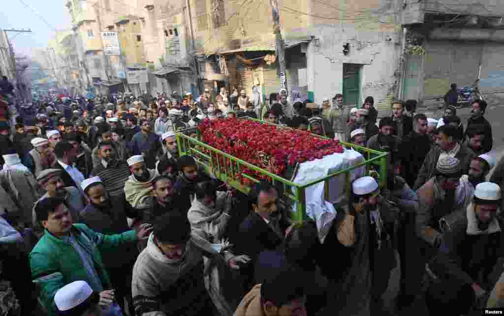 People carry the coffin of a male student who was killed in an attack by Taliban gunmen on a Pakistani army school in Peshawar that killed scores of people, mostly children. (Reuters/Fayaz Aziz)