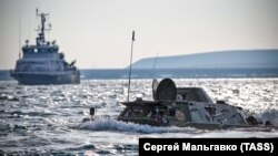RUSSIA - One of the two BRDM-2 amphibious armoured cars prepares to re-enact crossing the Kerch Strait from mainland Russia's Taman to Crimea's Kerch