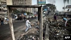 На месте ликвидированного лагеря сторонников Мохаммеда Мурси, Каир, 15 августа 2013 года