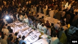 Crowd gathers around the bodies of the victims of the suicide bomb attack near the main border crossing between India and Pakistan.