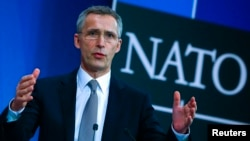 NATO Secretary-General Jens Stoltenberg speaks to reporters in Brussels about the alliance's plans to bolster its eastern flank.