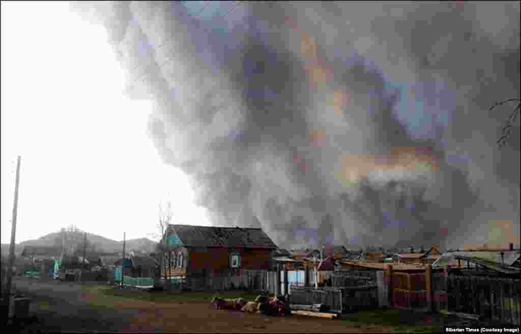 Dramatic pictures from The Siberian Times, reportedly taken on May 11, show wildfires bearing down on villages in Russia's Buryatia region.