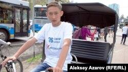 Водитель велотакси, представившийся Багдатом. Алматы, 14 апреля 2015 года.