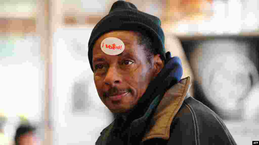 "A voter wears an ""I Voted"" sticker on his forehead after casting his ballot at a polling station in Chicago, Illinois."