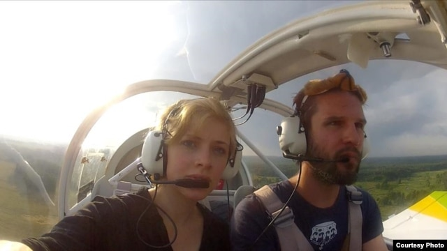 "Pilot Tomas Mazetti (right) and Hannah Lina Frey in the single-engine 1968 Jodel plane that they flew for ""Teddybear Airdrop Minsk 2012"" in July 2012."