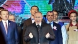 UKRAINE -- Russian President Vladimir Putin, center, gestures while speaking at an outdoor concert in Crimea's regional capital of Simferopol, Crimea, Monday, March 18, 2019.