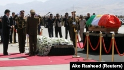 The coffin of former Iraqi president Jalal Talabani arrives at Sulaimaniya Airport on October 6.