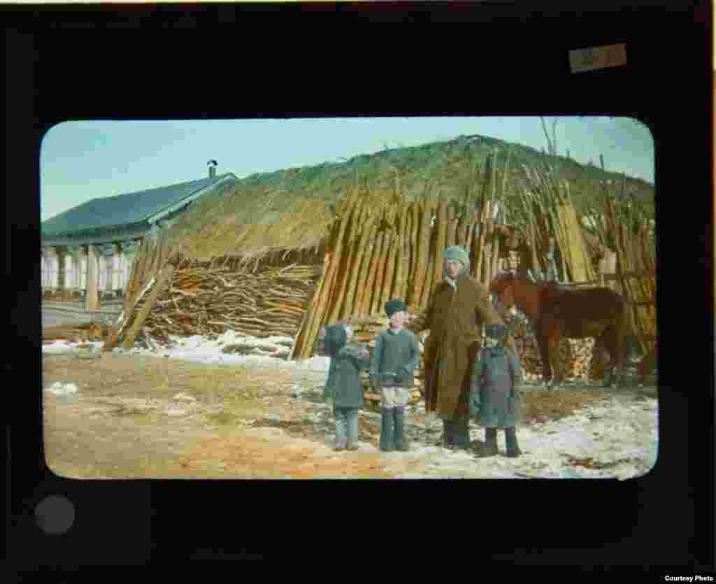 John Wells Rahill and three Russian boys in a small village
