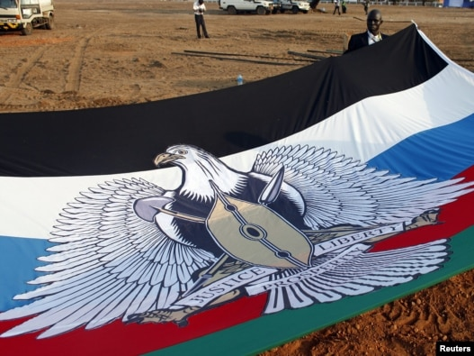 A South Sudanese flag is prepared for South Sudan's Independence Day celebrations in Juba.