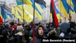 People attend a rally in front of the Ukrainian parliament on January 16, calling for lawmakers to recognize Russia as an aggressor state and implement other legislative changes concerning the occupied parts of eastern Ukraine.