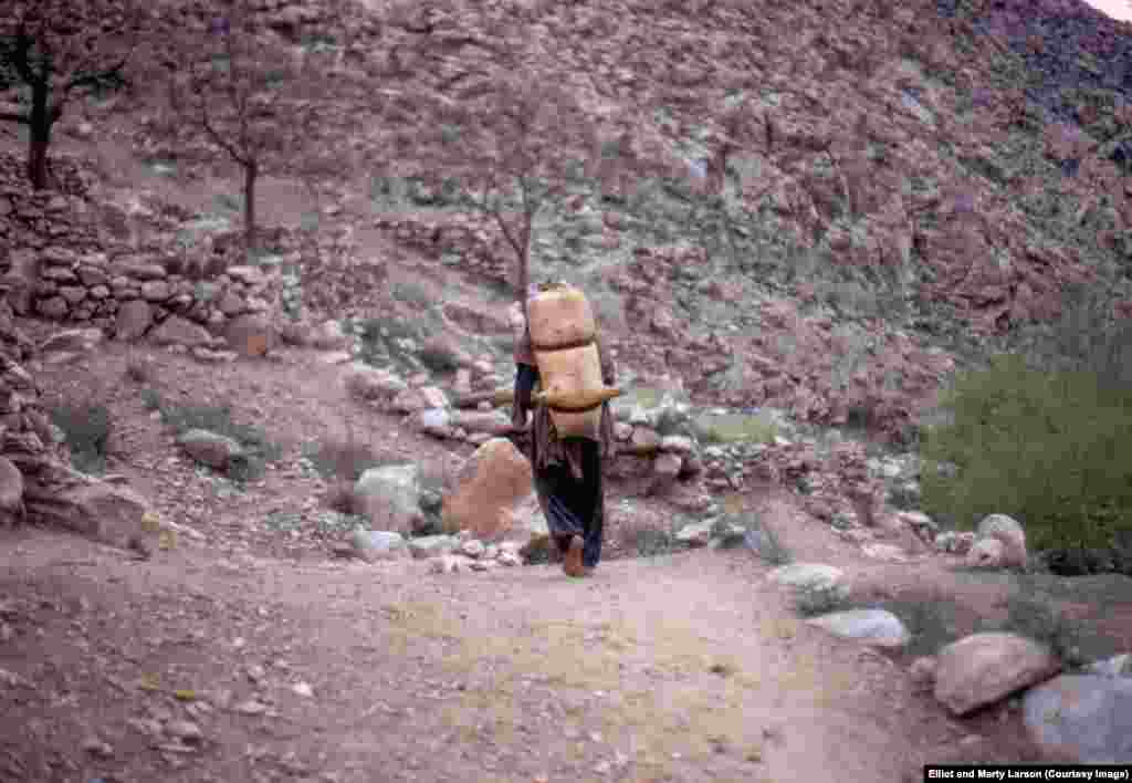 "A man with an animal-skin backpack, photographed during the outing to Nuristan. According to The Economist, the region is ""so tough that NATO abandoned it in 2010 after failing to subdue it."""