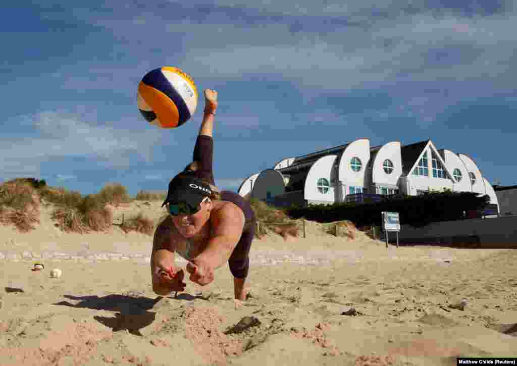 Volleyball player Victoria Palmer trains at Sandbanks Beach in Poole, England. (Reuters/Matthew Childs)