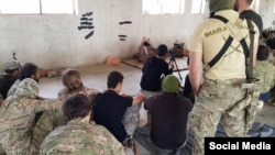 Photo from social media showing Uzbek militant and Liwa al-Muhajireen leader Abu Ubayda al-Madani lecturing militants in Syria.