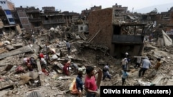 Nepal, Local residents clear the rubble from their homes which were destroyed after last week's earthquake in Bhaktapur, Nepal, May 2, 2015