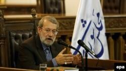File photo-Iranian Parliament Speaker Ali Larijani speaks during a press conference in Tehran, December 6, 2016