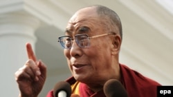 The Dalai Lama speaks outside the White House after meeting President Barack Obama.