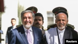 محمد اشرف غنی رئیس جمهور و عبدالله عبدالله رئیس اجرائیه افغانستان