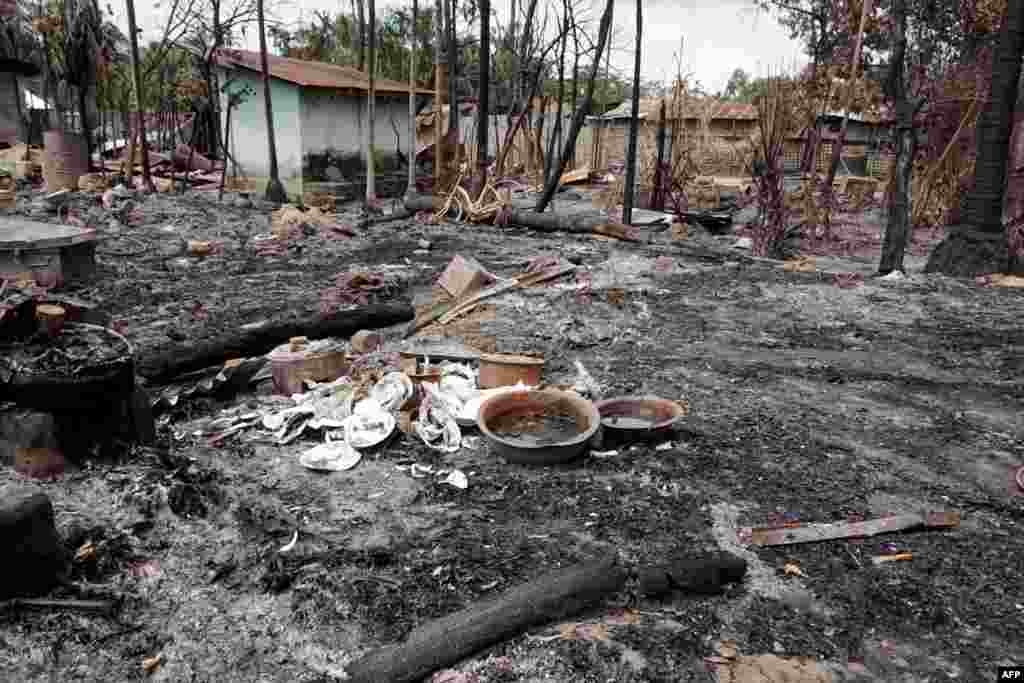 Charred remains of a house that was burned to the ground near the town of Maungdaw in Burma's northern Rakhine State, where the violence is ongoing.