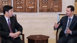 Цустрэча ў Дамаску прэзыдэнта Сырыі Башара Асада зь міністрам замежных спраў КНР Чжай Цзюнем, 18 лютага, 2012
