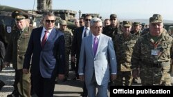 Armenia - President Serzh Sarkisian and Russian Defense Minister Anatoly Serdyukov (L) monitor CSTO military exercises at the Marshal Bagramian training ground, 19Sep2012.