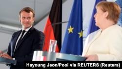 Франция президенти Эммануэль Макрон ва Германия канцлери Ангела Меркель.