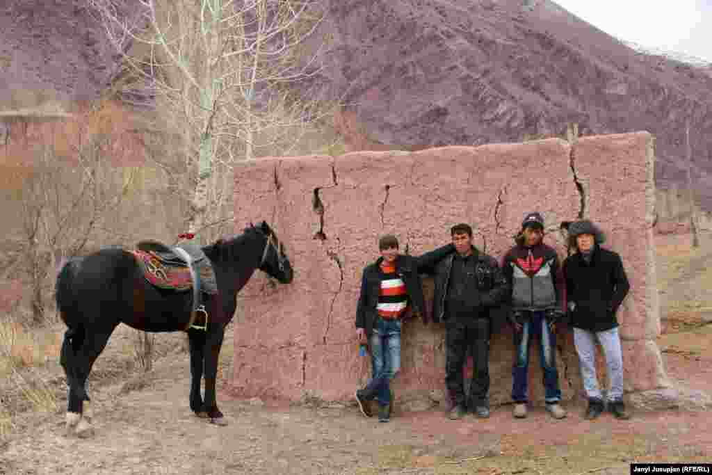 Nazim's son Akhmat (second from the left) with friends. They spend most of their free time riding horses to train for buzkashi, the popular sport that involves dragging a goat by horseback toward a goal. It is the major winter entertainment in all of Jerge-Tal district. Sometimes they also act as volunteer guides for the occasional foreign tourist.