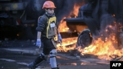 Twelve-year-old Roma Saveliyev is one of the most captivating interviewees in Evgeny Afineevsky's documentary Winter On Fire: Ukraine's Fight for Freedom, which has just been nominated for an Oscar.