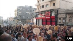 Antigovernment protesters in the Syrian port city of Banias