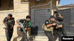 قوات عراقية خاصة خلال دورية في الرمادي - 30 تموز 2014