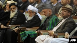 President Hamid Karzai (second from right) attends a Loya Jjirga gathering of tribal and political leaders in 2011.